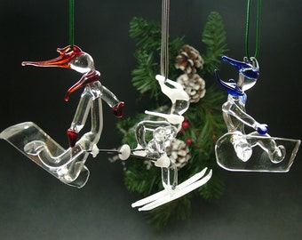 Unique Glass Ornaments. Choose a style, color, and quantity from our skier and/or snowboarder ornaments.