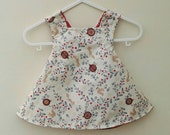 Reversible Christmas baby dress (3-6 mo)! Available up to age 7.