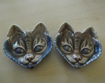 Pair Wade cat heads wall hangings