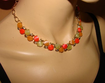 Colorful mid century choker style statement necklace.  Lovely vintage classic orange, yellow, salmon cabs surrounded by gold tone metal.