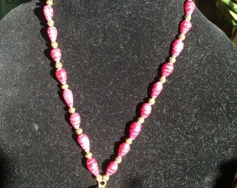 Ruby and brass necklace