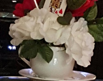 Alice in wonderland Tea cup floral arrangement