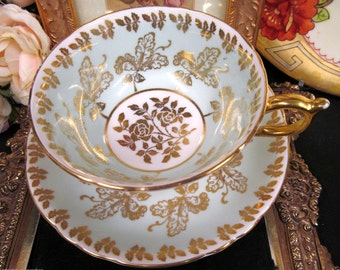 Paragon tea cup and saucer baby blue and gold gilt scroll roses pattern teacup