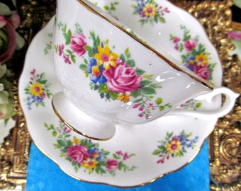 Royal albert tea cup and saucer avon shape wide mouth pretty floral pattern teacup