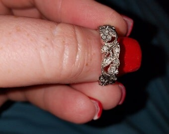 10k White gold Diamond ring with wide floral design band 4.4 gr.  size 6 1/2