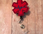 EMS/EMT badge reel - great gift for emergency medical service workers, paramedics, emergency services technicians - red emt symbol w/ blue