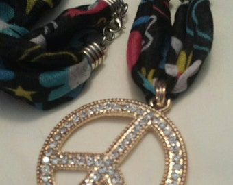 Gold and Clear Rhinestone Peace Sign on Peace Sign Fabric