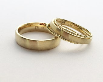 Wedding rings 585er yellow gold with two golden beads rings