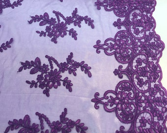 Pruple jasmine flower design embroider and corded on a mesh lace-yard