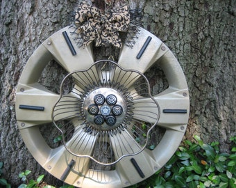 Hubcap yard art or Door decoration