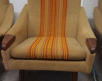 Pair of Danish sculptural lounge chairs in original fabric with teak, 1960s