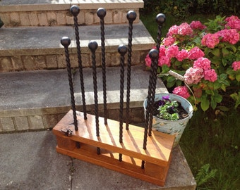 Handmade Boot Rack using reclaimed timber and hand twisted metal.