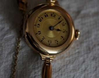 Ref: 157 ~14 kt yellow gold vintage Swiss Lady's wrist watch- Early 1960's.
