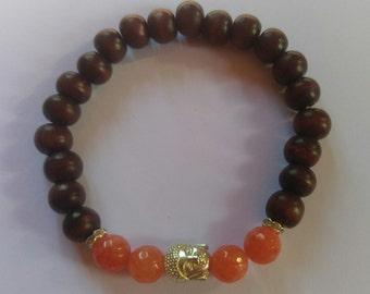 Handmade seed and stone bead with buddha head chakra bracelet.