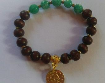 Handmade wood and stone bead with charm bracelet.