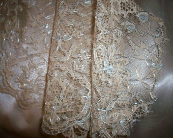 Fine antique french lace in tea and milk color with silver metal embroidery