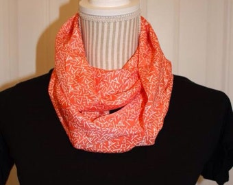 Orange infinity with white abstract lines