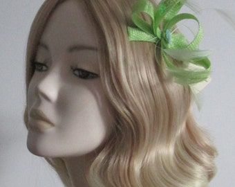 LIME GREEN FASCINATOR, Made of Sinamay, with stripped hackle feathers,and sequins,on a clip