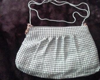 Gray hard sequenced purse