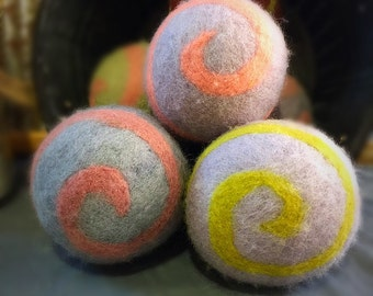 Ovella wool dryer balls. The Terra Swirl Collection Set of Nine (9) Naturally Dyed, colorful, earth tones, pink, purple, green, blue, yellow