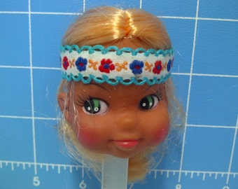 "Vinyl Indian Girl Doll Head Blonde Rooted Hair, White with Blue Trim and Flowers Headband, 3"" Tall with 3/4"" Neck"