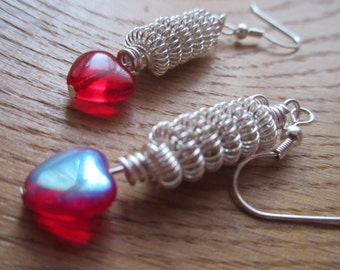 Wire wrapped earrings with heart beads.