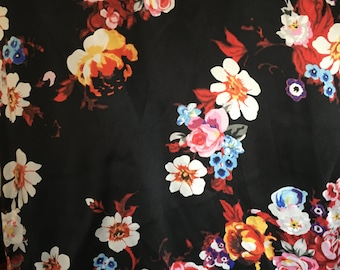 Beautiful 100% silk charmeuse floral on black fabric
