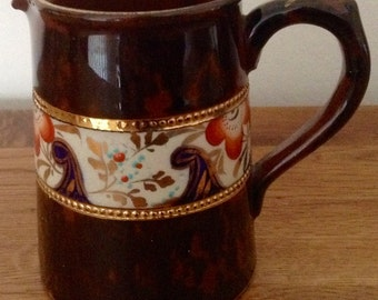 Vintage China/Porcelain Creamer. English. Features Central FloralLeaf patterned band edged in Gold Gilt.