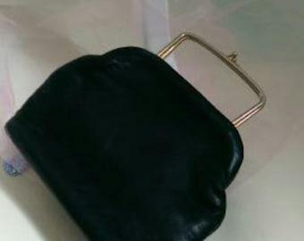 Black leather handbag with pink lining
