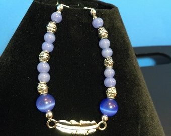 Silver Feather with Blue Catseye Glass Beads