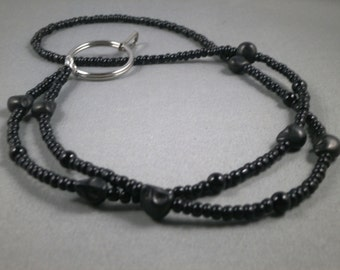 "Black turquoise skulls  ID lanyard . Your choice of lenght 32"" to 42"" and attachment ,ID,key or eyeglasses"