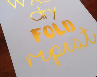 Wash Dry Fold Repeat foil print