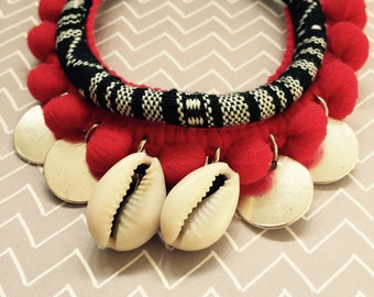 Ethnic bracelet with red strawberry.