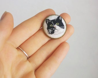 Custom embroidered pet portrait necklace or brooch.