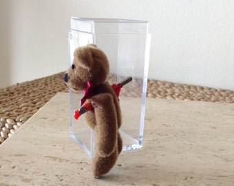 Burned by love again, Teddy. Stabbed in the back.  Handmade Bloody Mini Teddy Bear figurine in acrylic case.