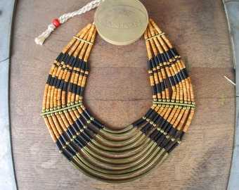African Style Layered Tan Disk Beads and Gold tone Metal bar Necklace