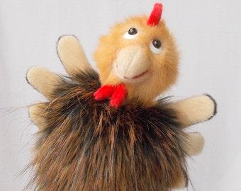 Chicken. Puppet. Bibabo. Toy glove. Toy on hand. Marionette. Puppet theatre.
