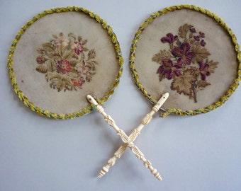 A Victorian lady's pair of hand embroidered face screens, circa 1850