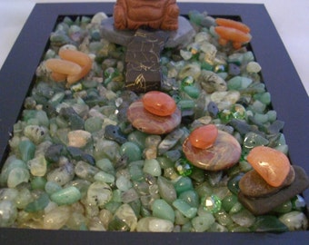 ZENGEM Garden. Protection from a Golden Sun Sitara Buddha with Agate and Carnelian rocks, little Carnelia on Aventurine and Crystal Chips