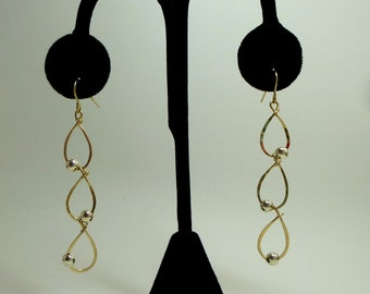 14 kt. gold filled tear drop  earring with alternating side sterling silver 5mm beads