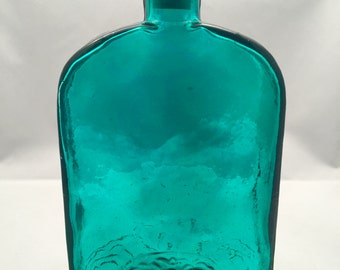 Emerald green glass bottle with cork