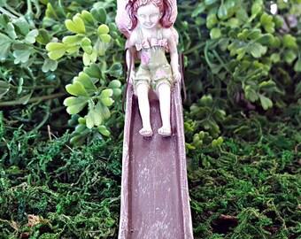 Miniature Fairy on a Slide