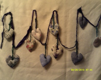 "Boho party bunting,garland.Ten double sided padded hearts on silk ribbon.93"" long."