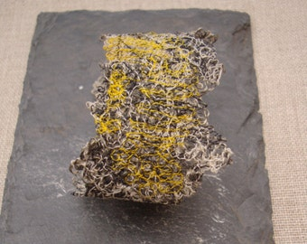 Wrist cuff machinestitched on soluble fabric, bracelet  made of linen and cottonthread, wrist cuff in grey and yellow