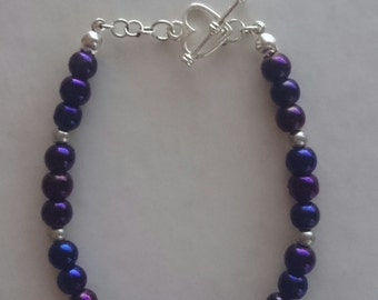 Purple pearl effect bracelet with silver plated heart clasp