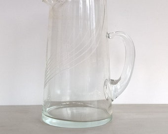 Vintage glass pitcher with etched lines
