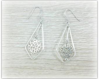 dangling earrings in sterling silver