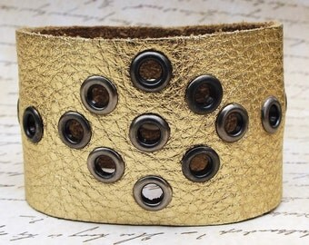 Wide Gold Leather Snap Cuff Bracelet with Gunmetal Eyelet Embellishments