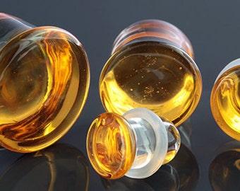 "Honey Colorfront single flare glass plugs:  14g, 12g, 10g, 8g, 6g, 4g, 2g, 0g, 00g (10mm), 7/16"" (11mm), 12mm, 9/16"" (14mm), 5/8"" (16mm)"