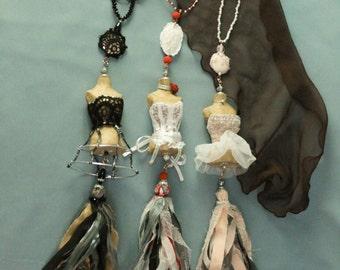 Decorative tasell mannequins vintage.